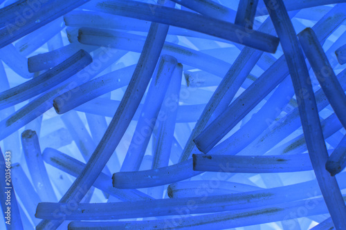 Plexiglas Abstractie image abstract blue background of curved short sticks