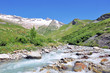 beautiful  snowy mountain and stream in summer