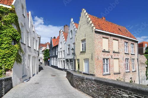 Plexiglas Brugge Houses along the canal in Bruges Belgium.