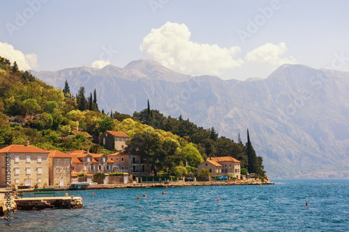 Fotobehang Blauwe jeans Sunny Mediterranean landscape. Montenegro, view of Bay of Kotor and ancient town of Perast