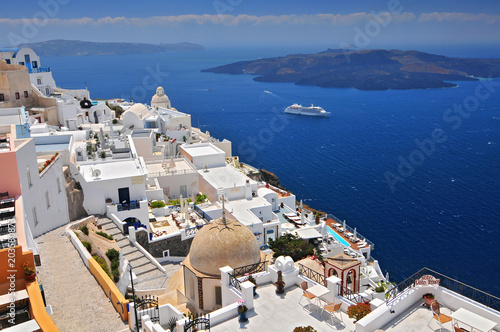 Fotobehang Santorini Afternoon view over town and ocean at Fira Thira Santorini Island Greece.
