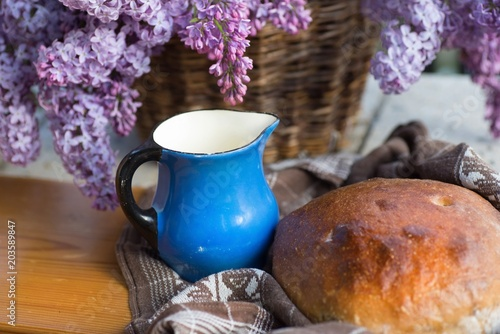 Bread,blue pitcher and lilac.