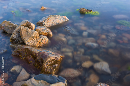Stones on the shore and in the water of the Black Sea, Anapa, Russia