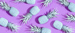 Painted pineapples on a vivid purple background