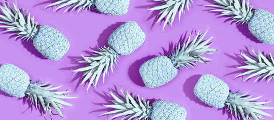 Painted pineapples on a vivid purple background © Tierney