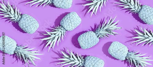 Painted pineapples on a vivid purple background - 203608287