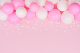 Pastel balloons and white confetti on pink background top view. Flat lay style. - 203637025