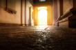 antico portone illuminato dal sole visto dall'interno