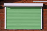 Closed green security shutters - 203655289