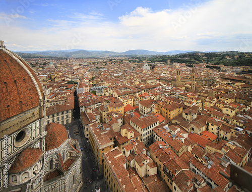 Fototapeta City panorama, aerial view, Florence, Tuscany, Italy; roofs, buildings, dome and towers.