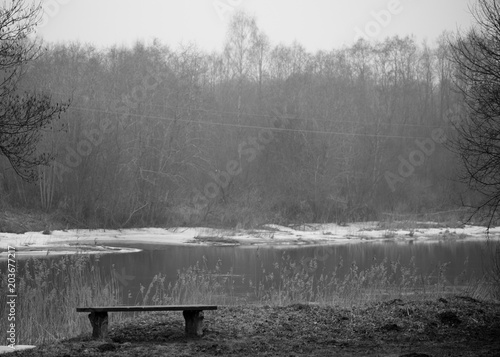 Plexiglas Lente Lithuania Landscape with Bench and River in Background.