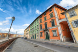 PISA, ITALY - APRIL 30, 2018: Beautiful view of Lungarni. Pisa attracts 5 million tourists annually