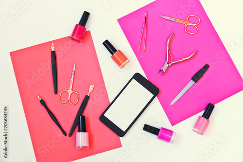 Plexiglas Manicure Manicure or pedicure equipment, nail polishes and smartphone on colorful background
