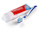 Toothbrush and tube of toothpaste isolated on white background. - 203686461