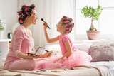 Mom and child doing makeup