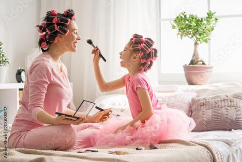 Fototapeta Mom and child doing makeup