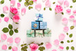 Quadro Roses and present boxes top view flat lay