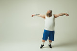 Graceful like swan. Full length portrait of calm fat man dancing with relaxation. Copy space - 203720200