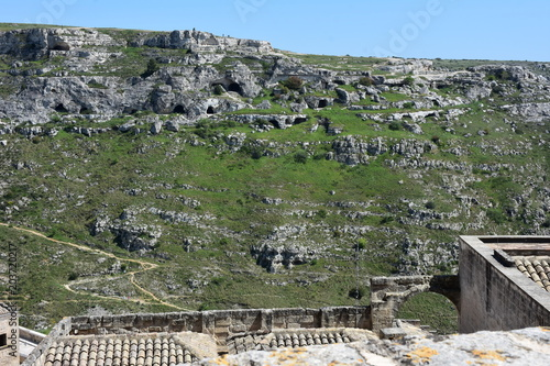 Aluminium Khaki Italy, Basilicata, Matera, city of stones, Unesco heritage, capital of European culture 2019. Hill with ancient caves in front of the city, on the river gravina