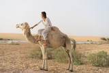 Camel riding in oasis
