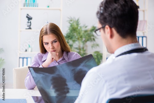Doctor examining x-ray images of patient - 203741686