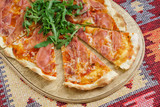 pizza with ham and arugula - 203743457