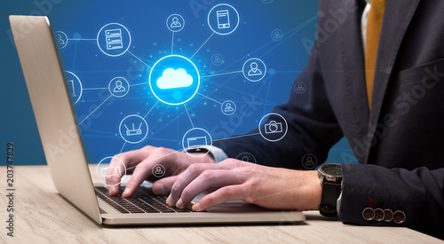 Foto Murales Businessman hand typing with cloud technology system and office symbol concept