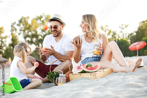 Family enjoying beach