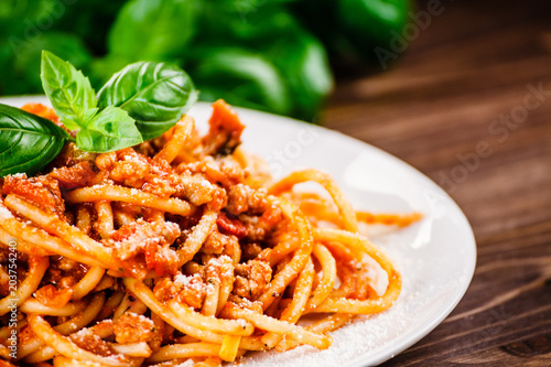 Fototapeta Pasta with meat, tomato sauce and vegetables