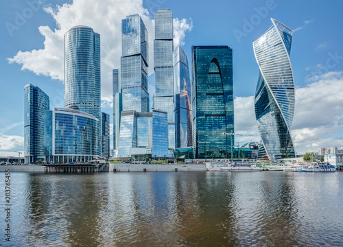 Plexiglas Moskou Skyscrapers on the river in Moscow on a summer day
