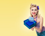woman in pin-up style clothing with gift box