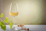 Glass of white wine on vintage wooden table - 203813018