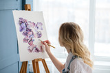 artist lifestyle. painting hobby. woman drawing beautiful watercolor floral design - 203815639