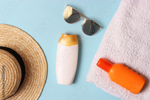 Plexiglas Spa sunscreen, towel, hat, glasses on a colored background. Cosmetics for safe sunburn. top view, flatlay
