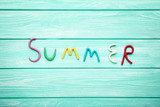Inscription Summer by plasticine on mint wooden table - 203838680