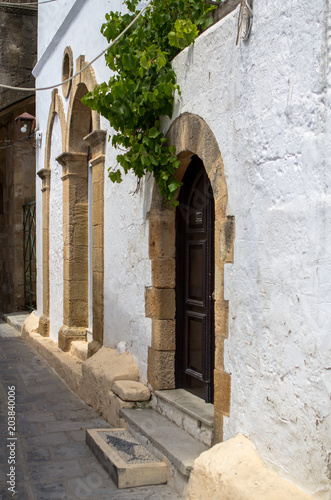 Narrow street in Lindos, Rhodes Island, Greece