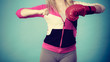 Woman holding boxing gloves