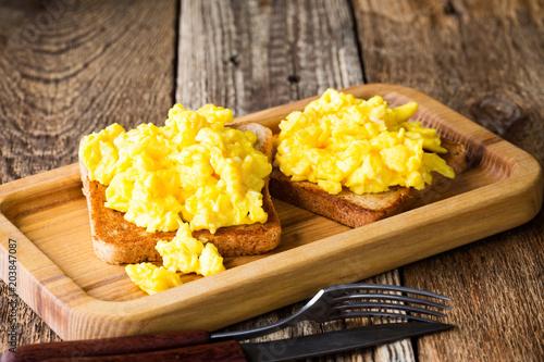 Fototapeta Scrambled eggs on two pieces of toast