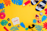 Header with traveling essentials flat lay on a vibrant yellow background. Summer vacation accessories, sunglasses, flip-flops, sunscreen, tiny swim ring, shells with feminine blue and pink palette. - 203856616