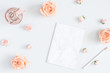 Quadro Feminine workspace with notebook, rose flowers, marble paper blank. Flat lay, top view, copy space
