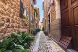 Silent cobbled narrow street in Fornalutx village, Majorca Balearic Islands