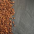 Quadro Coffee beans on a black background