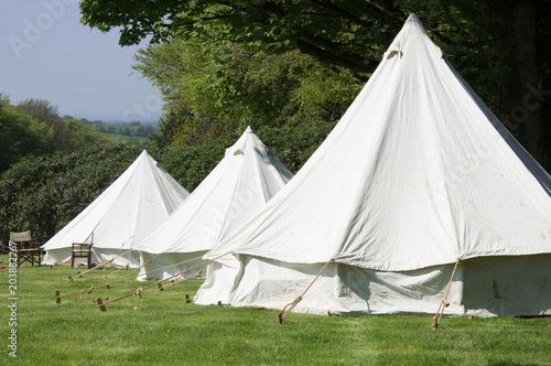 Old style double circular canvas tents in field & Old style double circular canvas tents in field | Buy Photos | AP ...