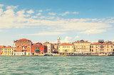 Picturesque summer view of Venice with famous water canals  and colorful historical buildings.
