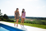 Happy girls smiling by the pool and enjoying summer - 203897222