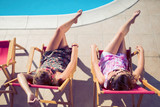 Girls enjoying summer vacation in chairs - 203897296