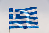 Greek flag on a pole floating in the wind - 203899255