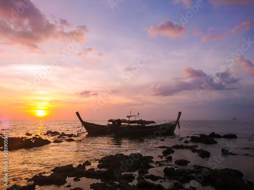 Sunset and Boat at Koh Bulone island, Panka Yai beach, Satun Thailand