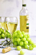 canvas print picture - Two glasses of white wine,cheese and grapes.
