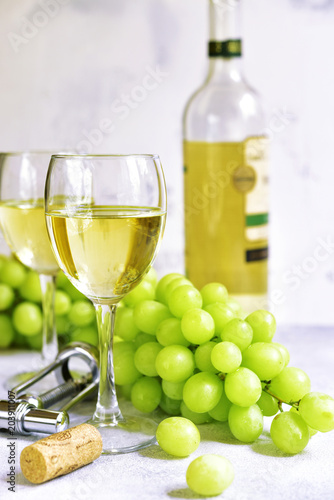 canvas print picture Two glasses of white wine,cheese and grapes.